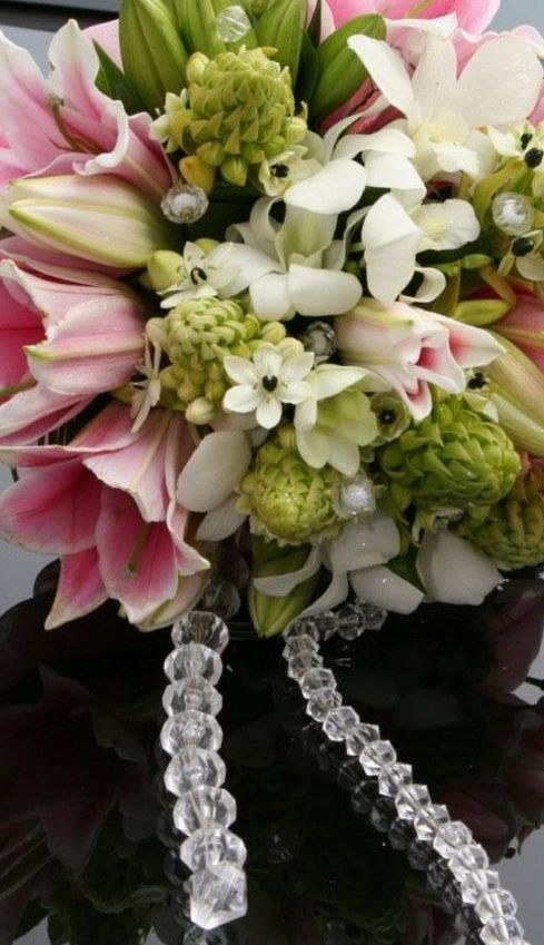 bridal bouquet lilies and roses