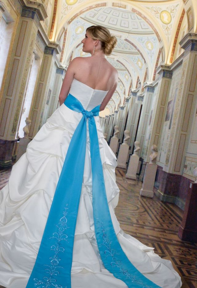 bridal dress with blue ribbon