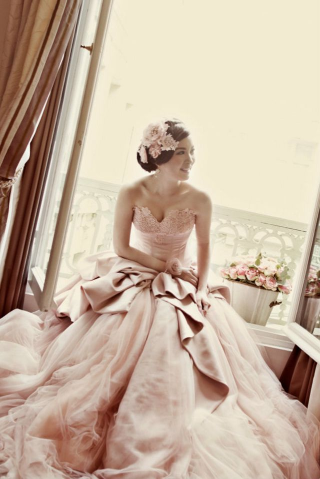bridal dress with pink ribbon