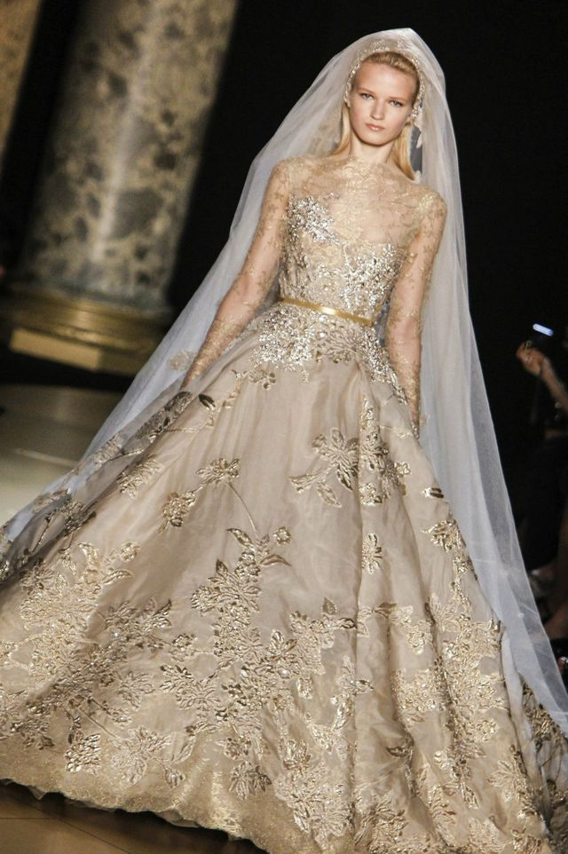 wedding dress with gold ribbon