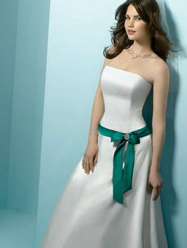 wedding dress with green ribbon