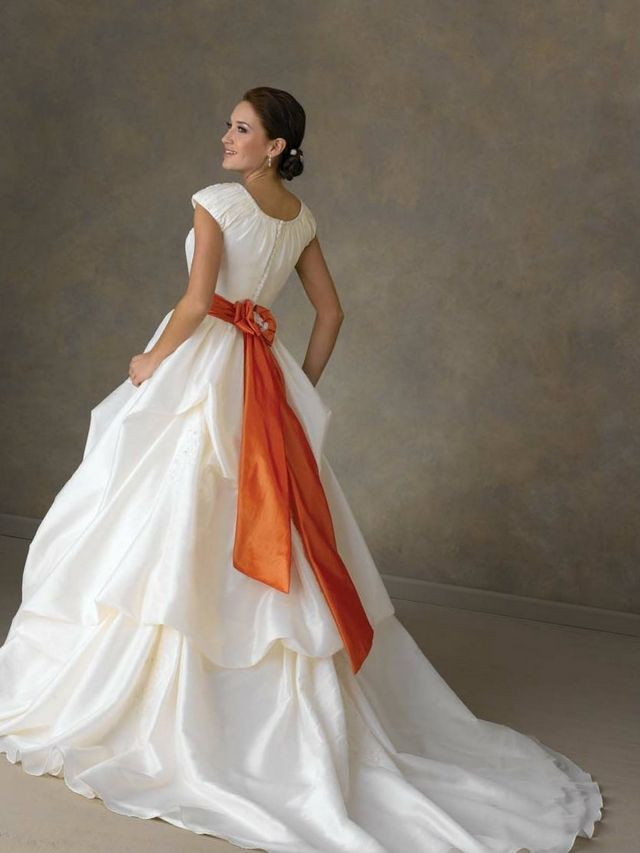 wedding dress with orange ribbon