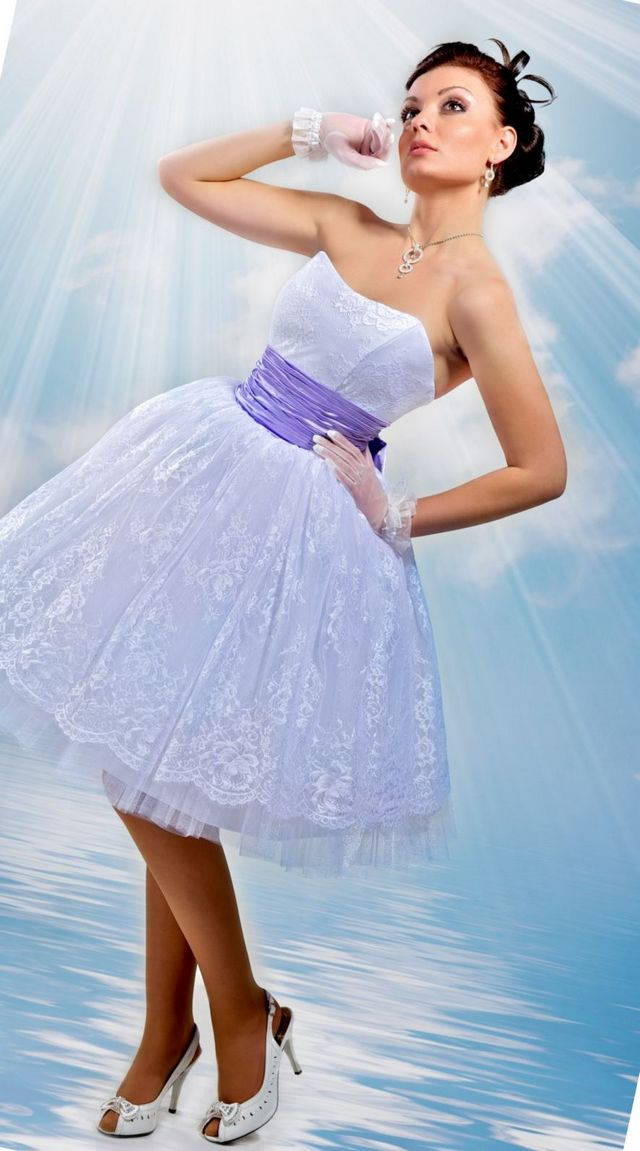 wedding dress with purple ribbon