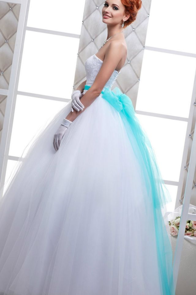 wedding dress with turquoise ribbon